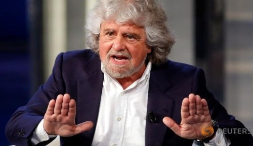 Leader of the Five Star Movement and comedian Beppe Grillo gestures as he appears as a guest on the RAI television show Porta a Porta (Door to Door) in Rome, May 19, 2014.