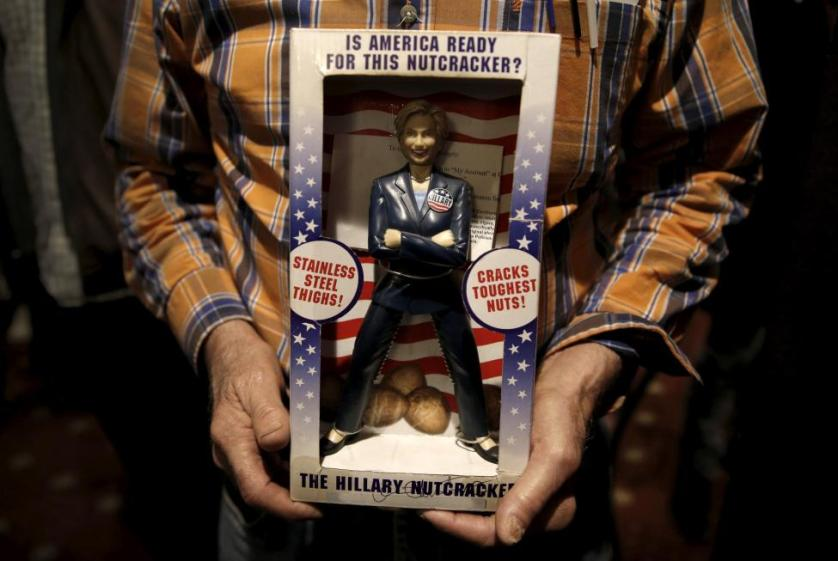 A man holds a souvenir Hillary Clinton nutcracker as he waits during a John Kasich campaign stop at the Puritan Backroom Restaurant in Manchester, New Hampshire, February 6, 2016. REUTERS/Mike Segar