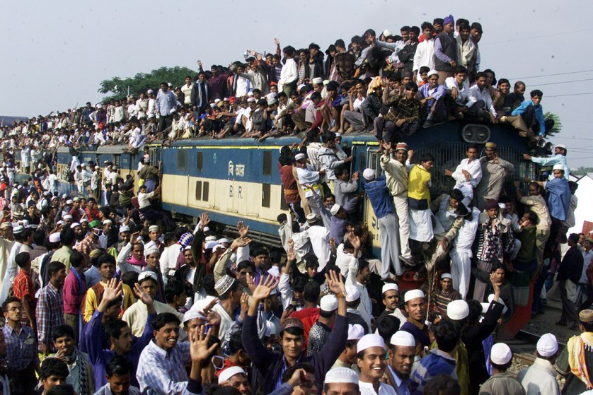 An overcrowded train leaves a platform in Tongi near Bangladesh's capital Dhaka in 2003, as pilgrims flock to the annual Ijtema Muslim gathering