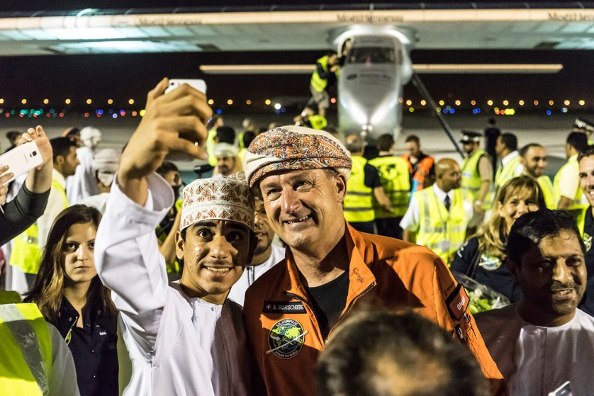 9 March 2015: Andre Boschberg poses for a photo with a local man after he landed Solar Impulse 2 in the Omani capital, Muscat