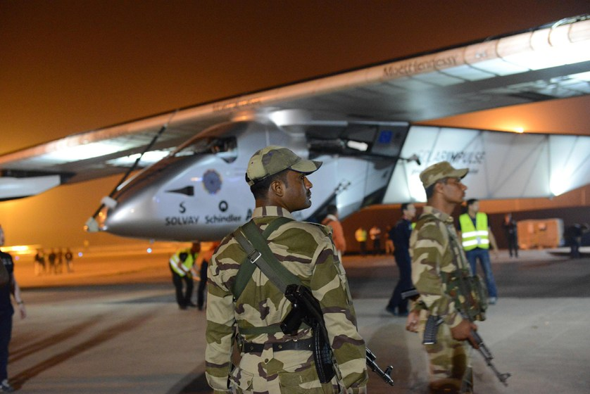 10 March 2015: Armed Indian paramilitary soldiers stand guard after Solar Impulse 2 landed at Sardar Vallabhbhai Patel International Airport in Ahmedabad, the main city of western India's Gujarat state