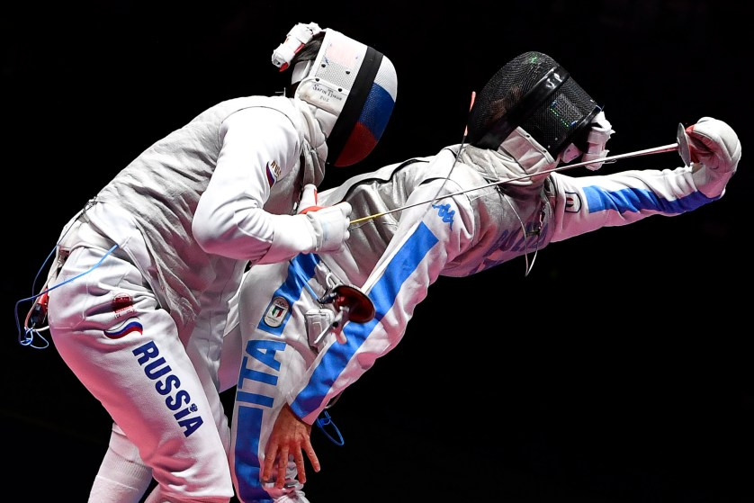 TOPSHOT - Russia's Timur Safin (L) competes against Italy's Daniele Garozzo during their mens individual foil semi-final bout as part of the fencing event of the Rio 2016 Olympic Games, on August 7, 2016, at the Carioca Arena 3, in Rio de Janeiro. / AFP / Fabrice COFFRINI        (Photo credit should read FABRICE COFFRINI/AFP/Getty Images)
