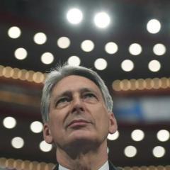 Britain's Hammond promises new economic plan to handle Brexit turbulence