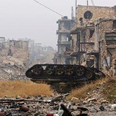 Происходящее в Алеппо является неприемлемой трагедией, заявил Джентилони