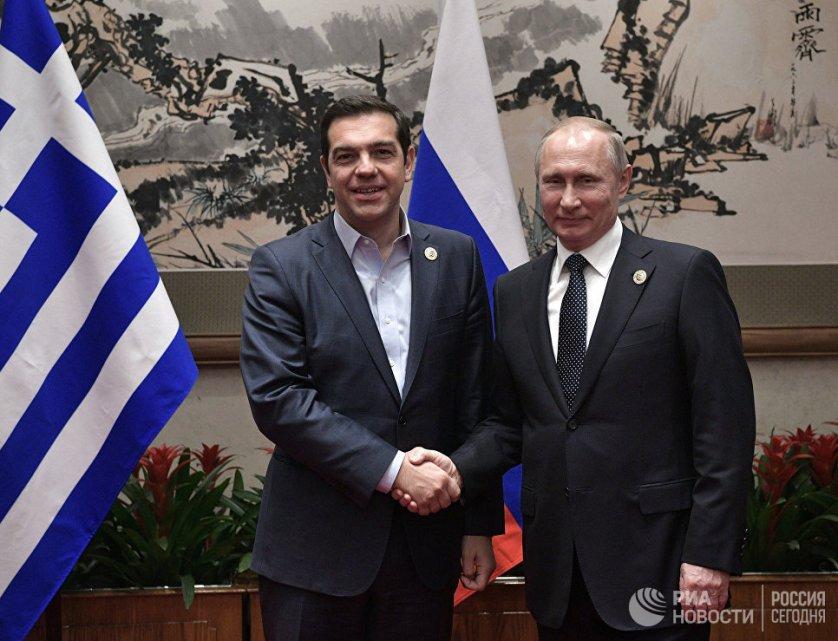 Президент России Владимир Путин и премьер-министр Греции Алексис Ципрас.