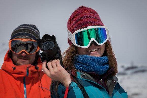 a man and woman wearing woollen beanies and ski goggles in the arctic