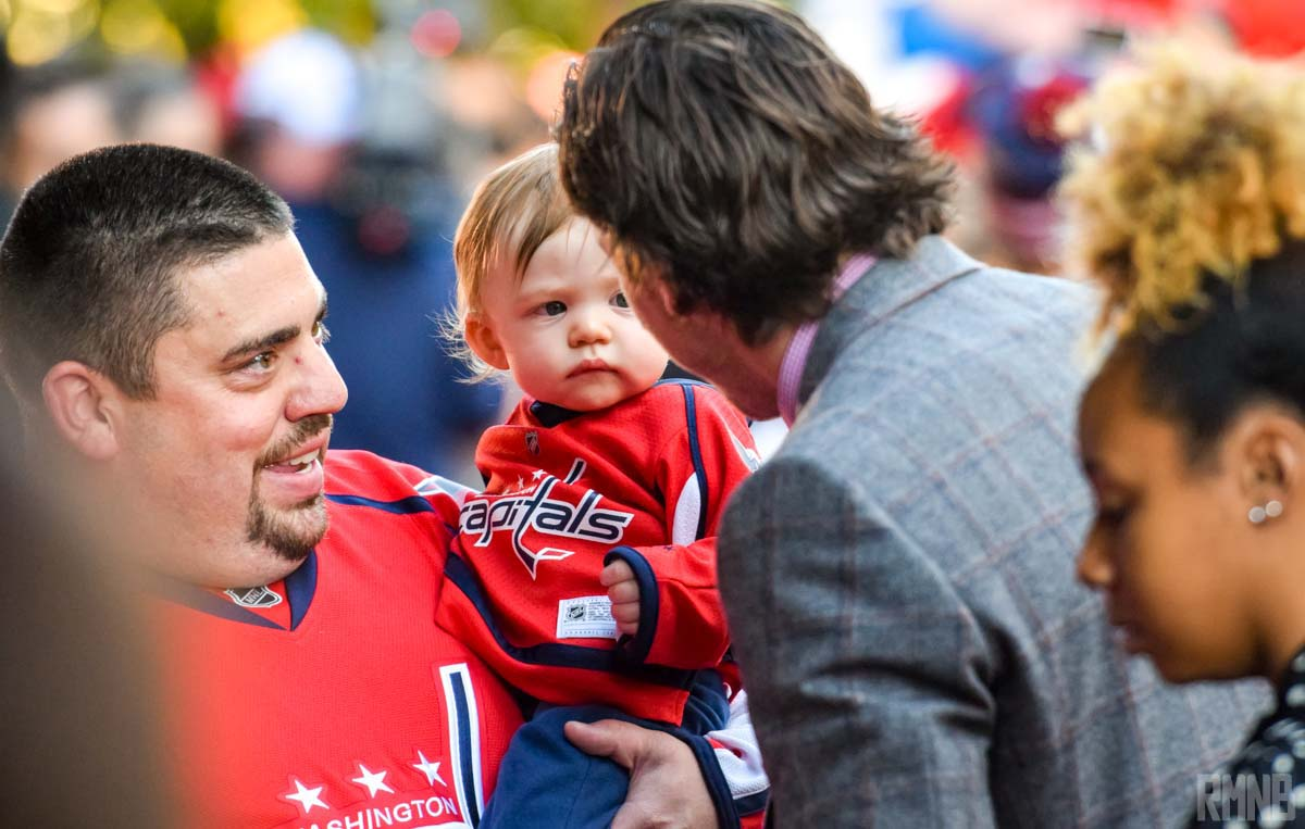 TJ Oshie says hello to a baby Caps fan