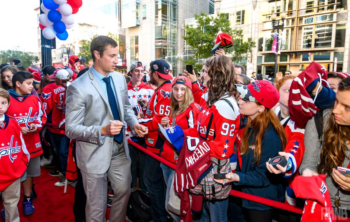 Jay Beagle speaks with Caps fans while walking down the red carpet
