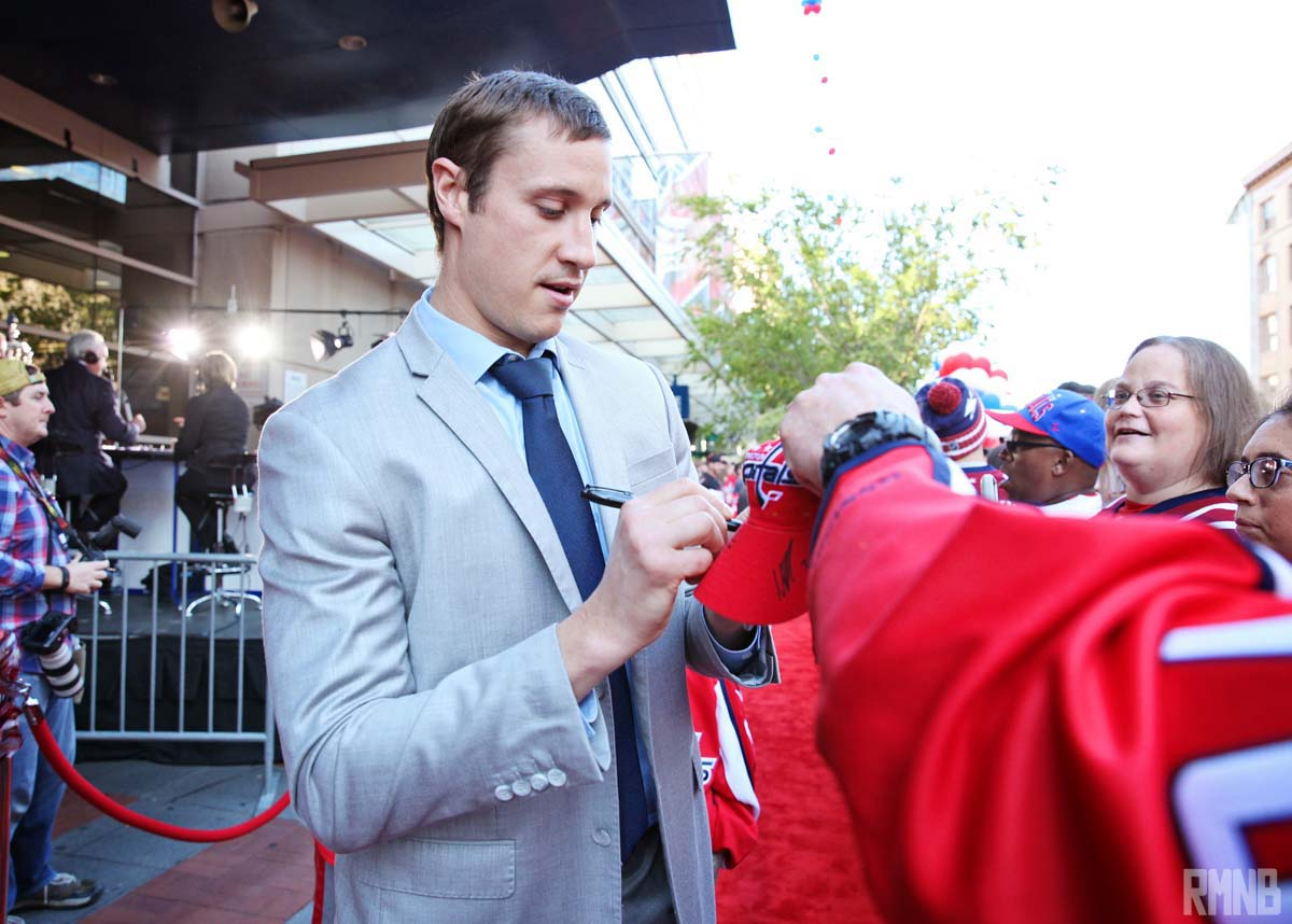 Jay Beagle continues to sign autographs for fans