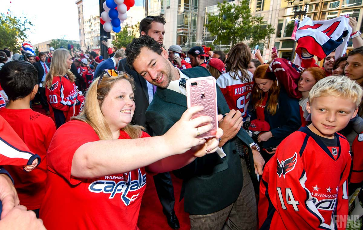Justin Williams poses for a selfie on the red carpet