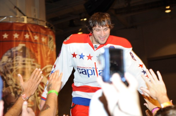 Alex Ovechkin high-fives fans during the unveiling of the Caps Winter Classic Jerseys