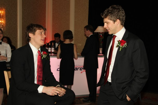 Alex Semin and Semyon Varlamov talk to each other at Caps Care Casino Night