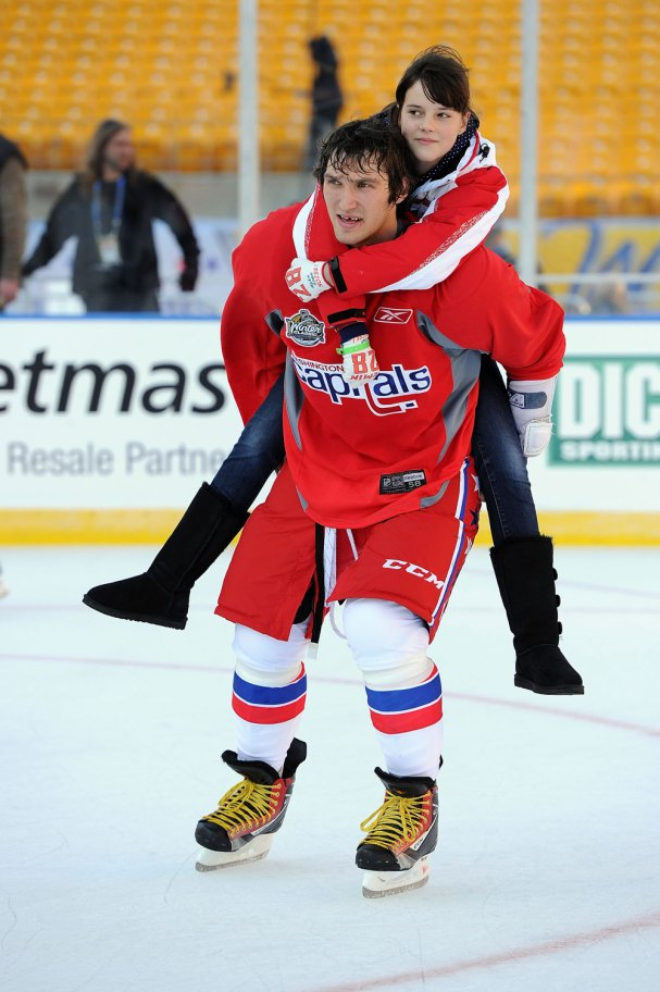 Cute moment: Ovi skates around with one of Alex Semin's relatives