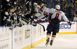 Alex Ovechkin celebrates with his teammates after scoring the game's decisive goal. (Photo credit: Mike Carlson)