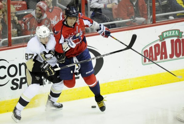 Alex Ovechkin checks Sidney Crosby