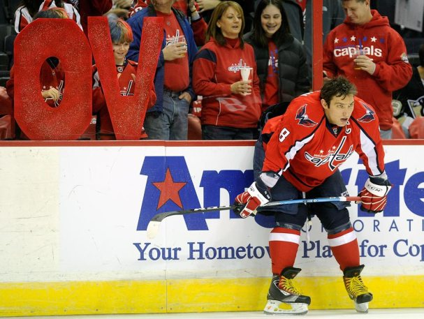 Alex Ovechkin sits against the boards during warm-ups.