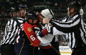 Alex Semin Getting Some With Cory Stillman (Both Photos by: Eliot J. Schechter)