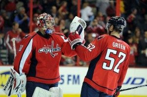 Michal Neuvirth and Mike Green celebrate their 7th straight victory at home. (Photo credit: Greg Fiume)