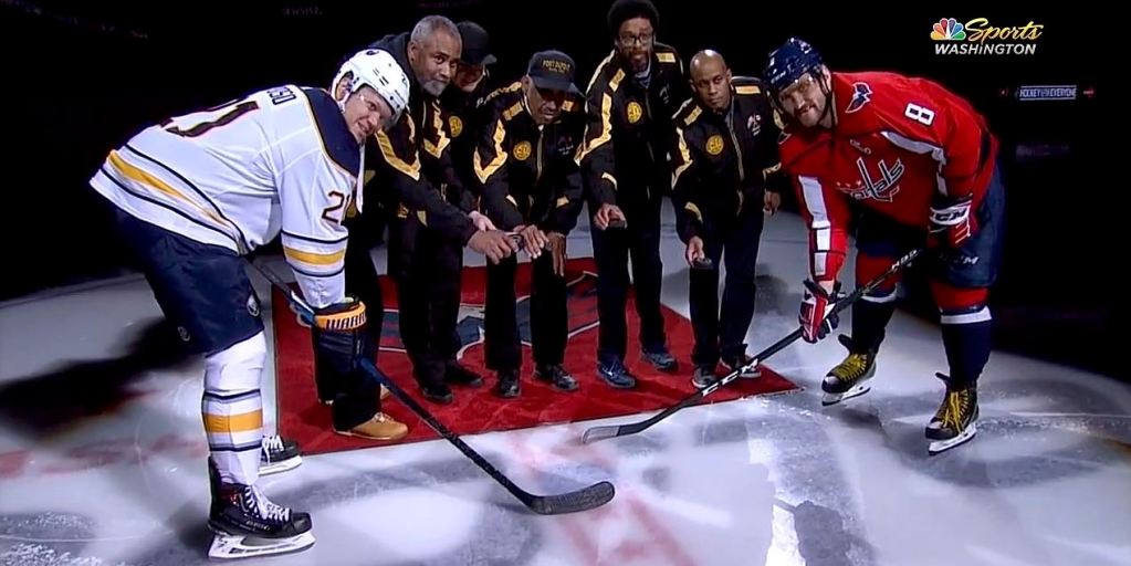 529121c0bb7 Capitals honor Fort Dupont coaches during ceremonial puck drop