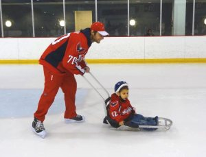 Holtby skates Zachary around the ice. (Photo credit: Ann-Marie Ward)