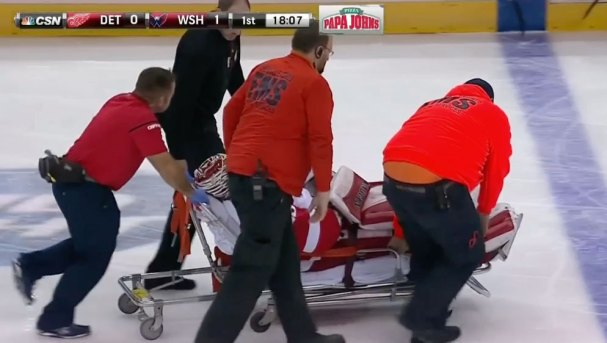 howard-stretchered-off