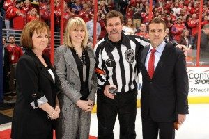 NHL referee Bill McCreary is honored with his wife Mary Ann and daughter Melissa, along with Vice President and Caps General Manger George McPhee of the Washington Capitals before officiating his final NHL game
