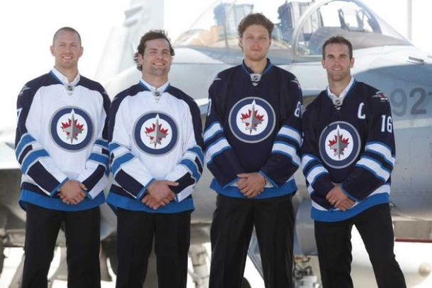 Eric Fehr, Mark Stuart, Nik Antropov, and Andrew Ladd (Photo credit: John Woods)