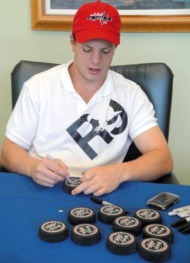 john-carlson-signing-pucks