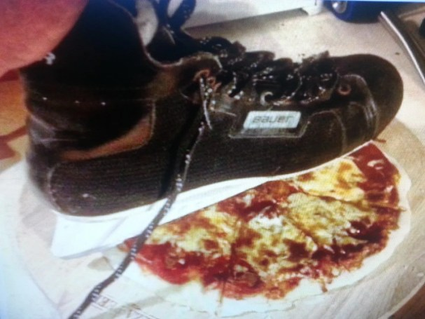 kevin-kaminski-slicing-pizza-with-hockey-skate