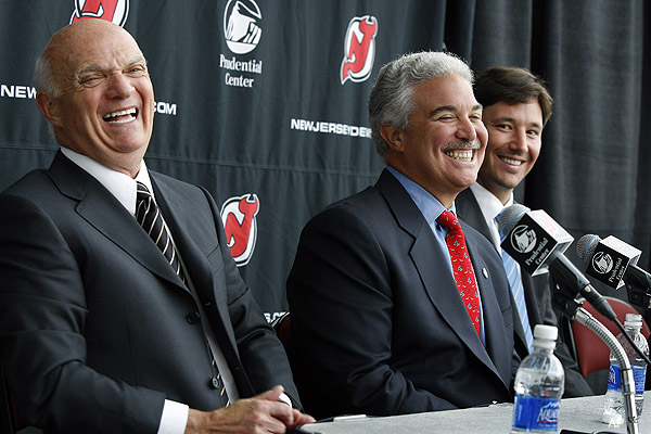 New Jersey Devils general manager Lou Lamoriello, left, and star forward Ilya Kovalchuk, right, share a laugh Tuesday, July 20, 2010, with owner Jeff Vanderbeek. (Photo by AP Photo/ Mel Evans)