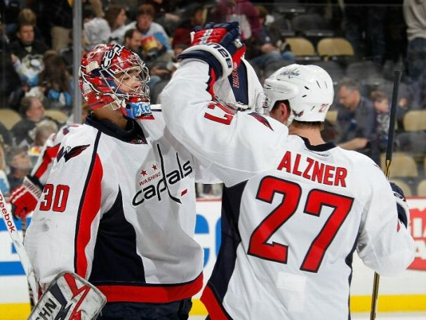 Michal Neuvirth and Karl Alzner celebrate after the Capitals 1-0 shutout of the Penguins