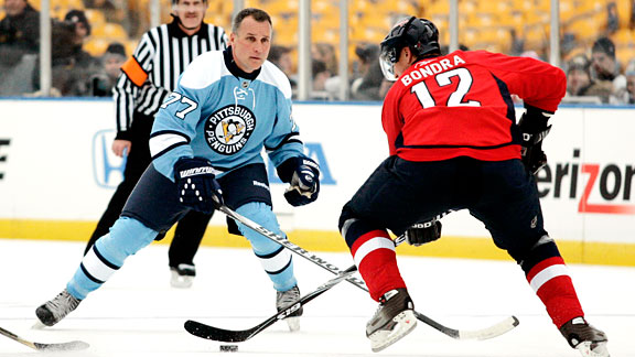 Peter Bondra, going against Paul Coffey, skates into the offensive zone. (Photo credit: ESPN)