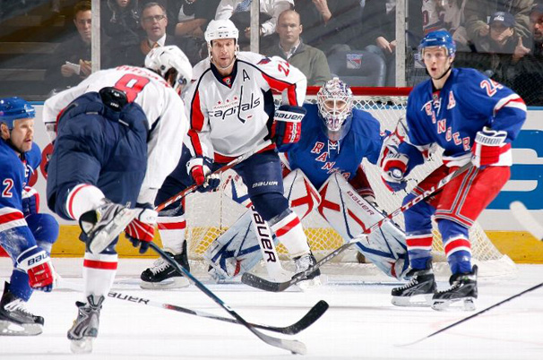 Alex Ovechkin shoots through a maze of Rangers and Capitals players