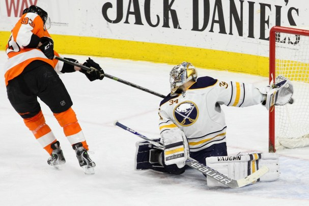 NHL 2015 - Feb 19 - BUF vs PHI - Right Wing Jakub Voracek (#93) of the Philadelphia Flyers scores against Goalie Michal Neuvirth (#34) of the Buffalo Sabres