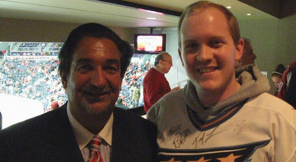 Ted Leonsis posing with Addison Huber inside the Owner's Box