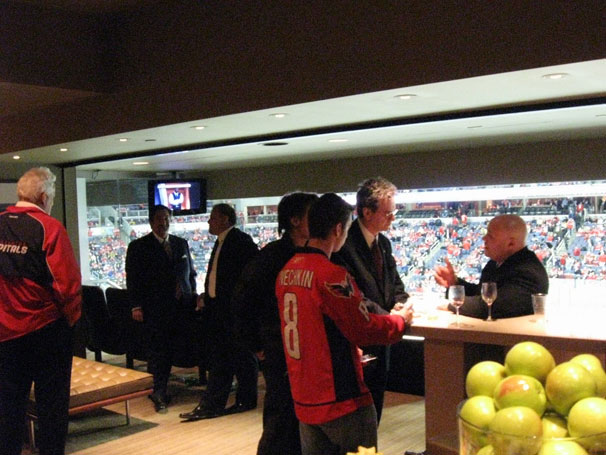 Ted Leonsis chatting with others inside Owner's Box