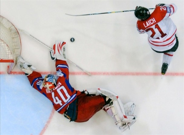 Semyon Varlamov stops Brooks Laich on a shot attempt. Russia vs Canada World Championships.