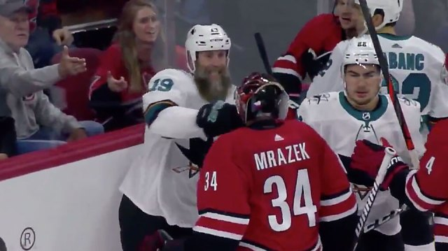Joe Thornton drops goaltender Petr Mrazek with a single punch