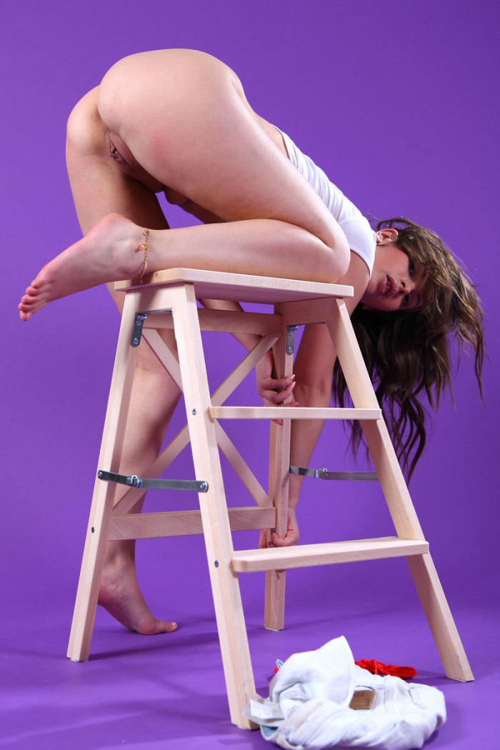 Teen Juliette D on chair in purple room  Russian Sexy Girls