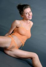 Flexible dame with shaved beaver takes off her undies 1
