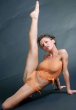 Flexible dame with shaved beaver takes off her undies 2