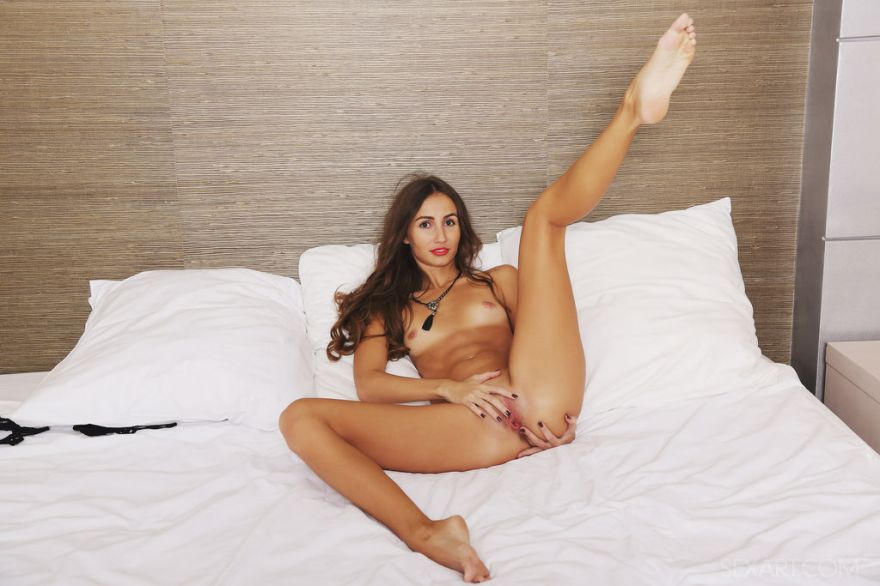 Sandy A in sexy black lace lingerie before getting naked on top of the bed