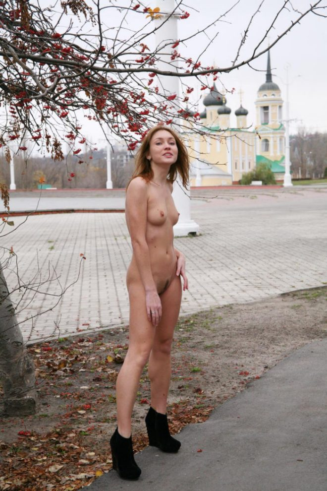 Sexy blonde spreads her legs in the city square