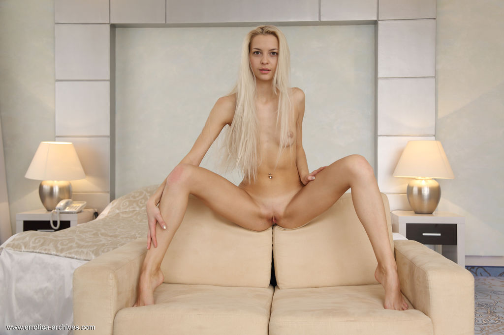 Leonie Naked, Slender Body With shaved pussy On The Couch 1