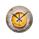 Cheesecake on rustic wood cake top. round wall clocks