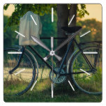 Bicycle Leaning Against a Tree Next to a Dam Square Wall Clock