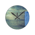 blue kitchen towel on rustic wooden background round clock
