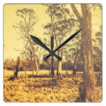Waratah landscape in sunlight square wall clock