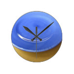 Empty color blue ceramic plate on straw paper round clock