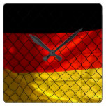 Germany Flag behind Chain Link Fence Square Wall Clock